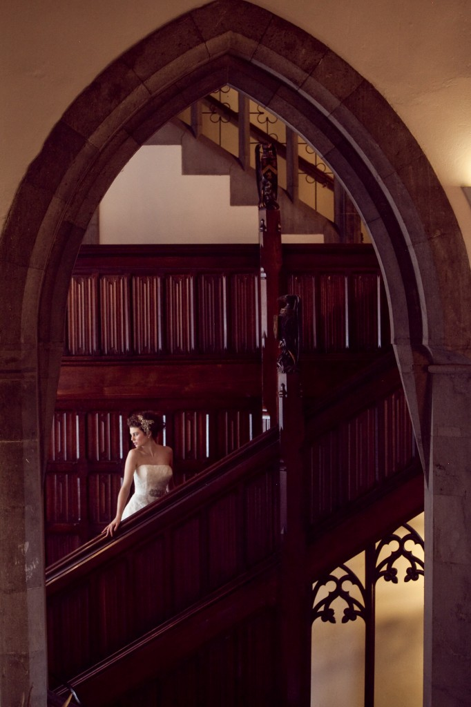 Autumnal Wedding arch in the manor house with bride walking down stairs