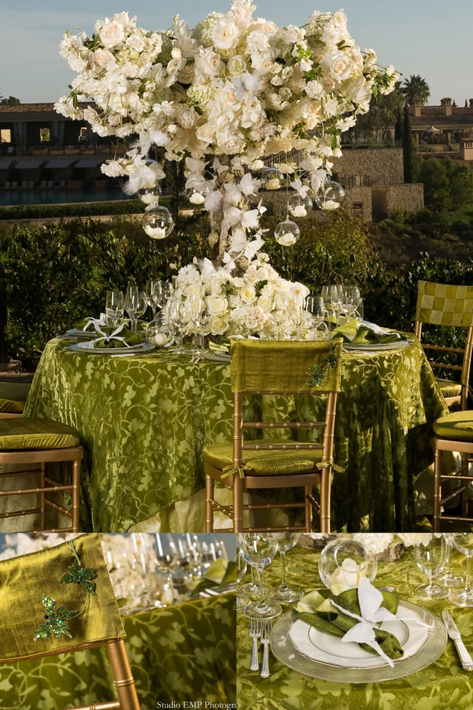 luxury linens  table in green with flowers in the middle