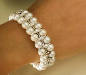 pearl bangle around a tanned arm Real Bling