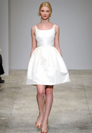 model on catwalk with a Short Wedding Dresses