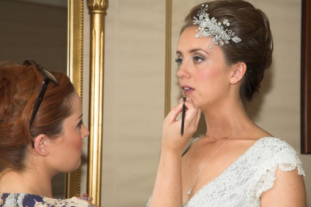 Elegant Affair bride having her make up done