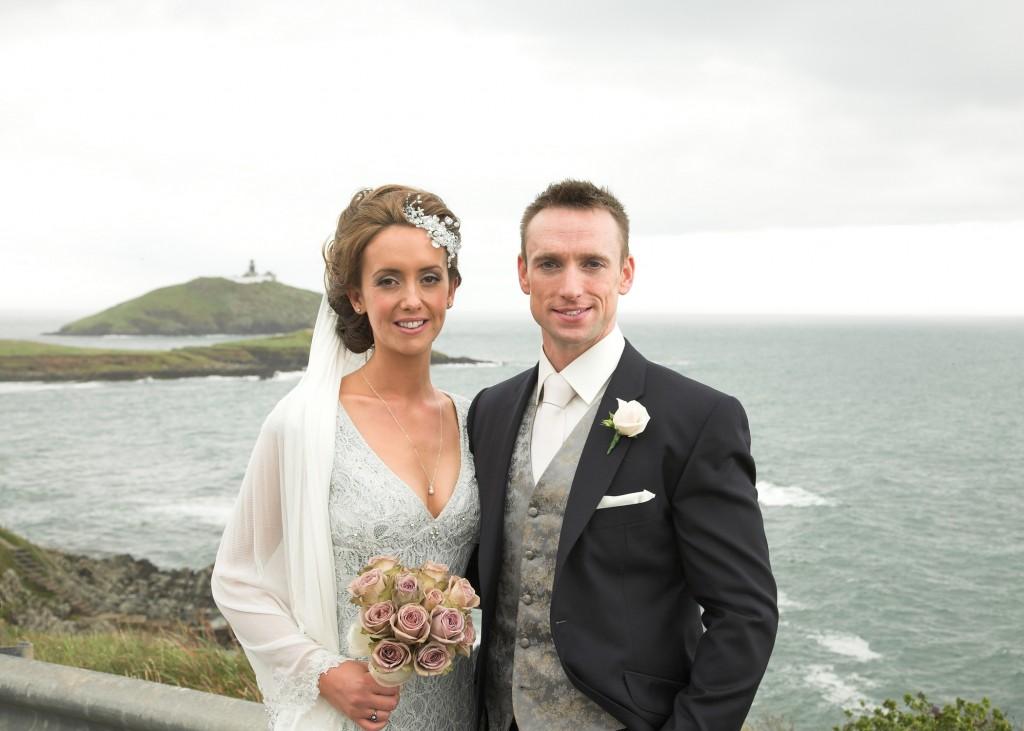 Elegant Affair couple posing beside the sea