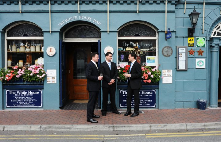 intimate Kinsale boys outside pub before the wedding