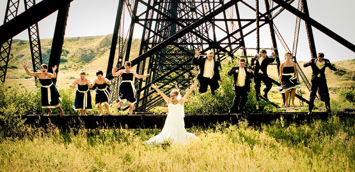 Out of Your Comfort Zone bridal party in a field