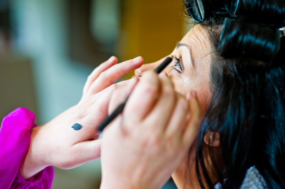 boutonniere putting on eye liner Beautiful and Intimate-Farrah and Paul
