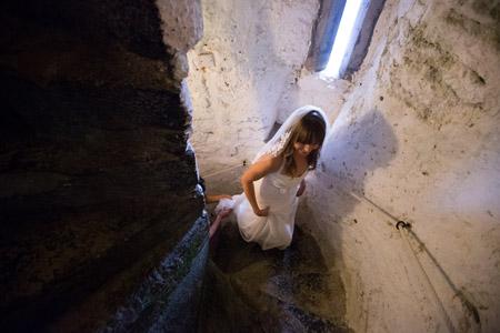 Castle and a Céilí bride climbing the castle stairs