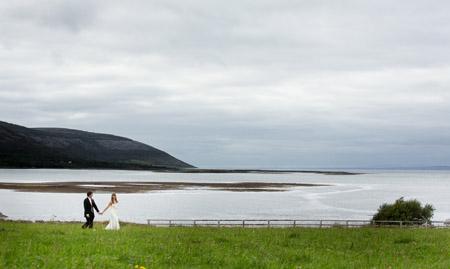 Castle and a Céilí bridal couple having a walk by the sea