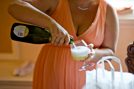 castles and California bridesmaid pouring champagne