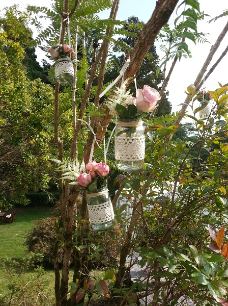 hanging jam jars with flowers