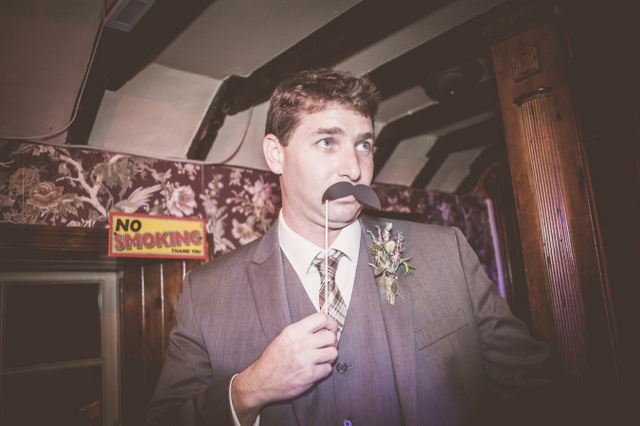Castle wedding groom with false moustache