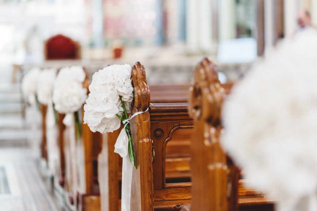 white hydrangea Pew ends wedding church