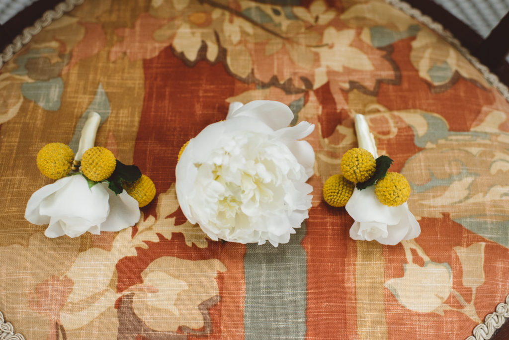 Yellow and white grooms boutonnieres