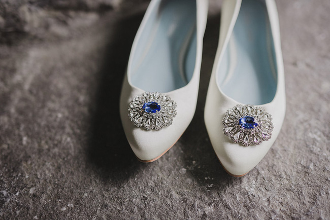 White wedding shoes blue broach