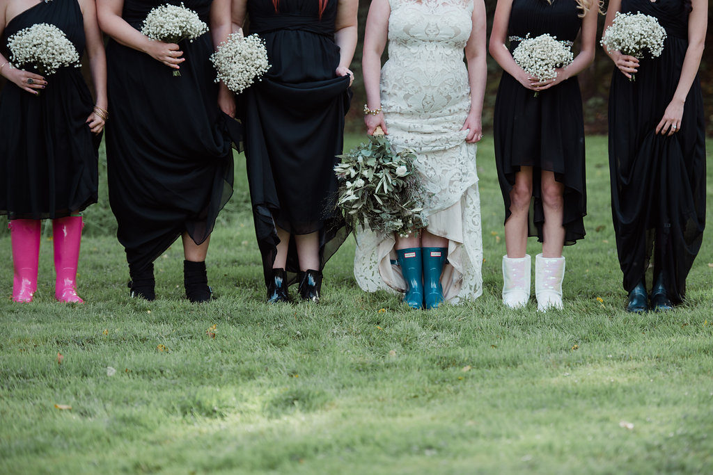 destination wedding in a barn Aislinn Events bridal party in welly boots