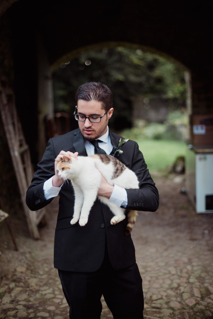 destination wedding in a barn Aislinn Events groom with cat