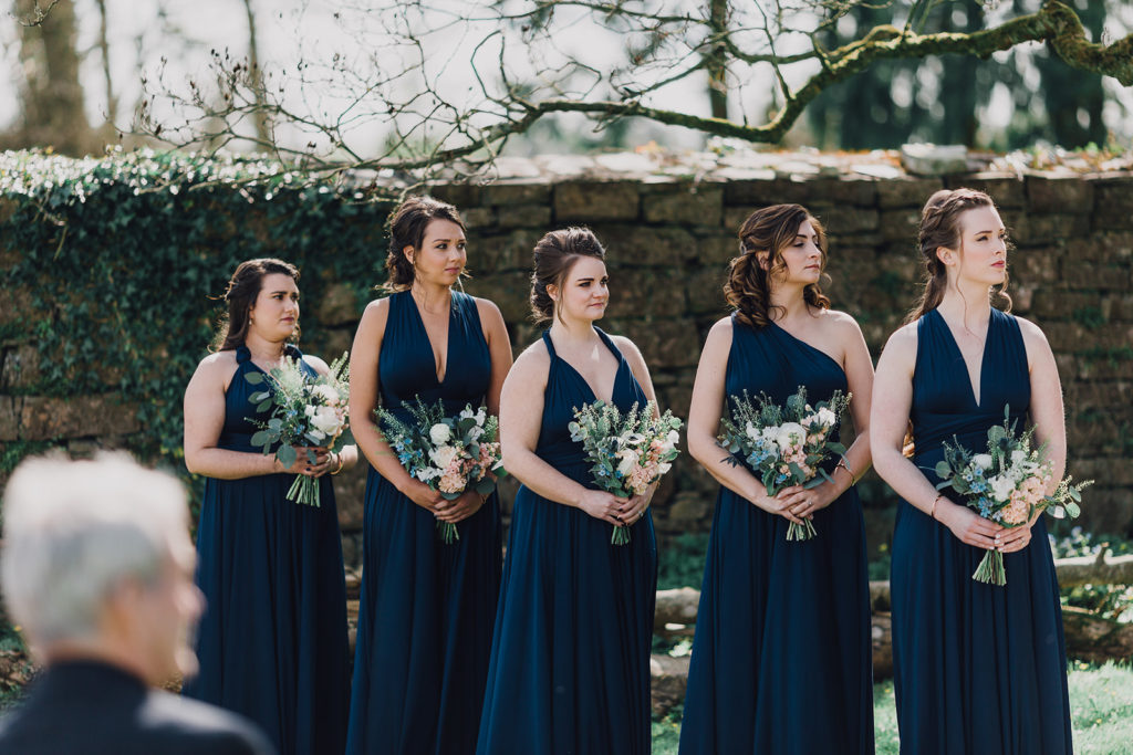 navy bridesmaids dresses, blue and nude flowers outdoor destination wedding Ireland AislinnEvents.com